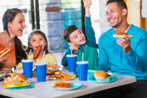 A family enjoying a fast food meal