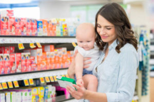 A woman shopping for baby products at pharmacy
